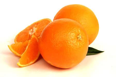 Citrus fruit oranges, whole and sliced Stock Photo