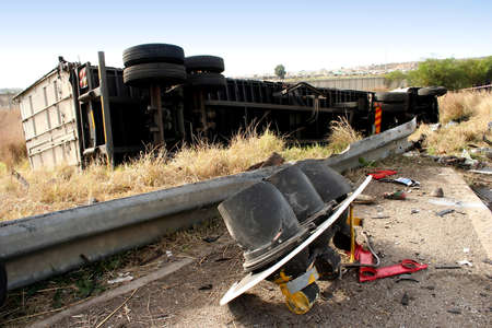 overturned: An overturned truck as a result of failed brakes