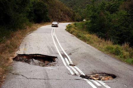A badly damaged road due to heavy rain falls