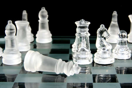 The end of a chess game with the king lying down in resignation Stock Photo - 1448743