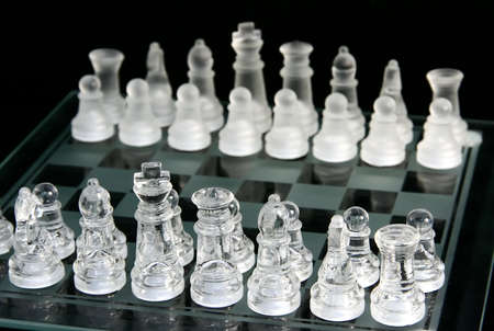 conquered: The beginning of a chess game with the pieces in place Stock Photo