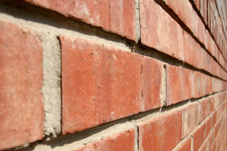 converging: Close up of a brick wall with converging lines