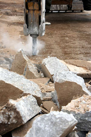 breaking up: A impact digger breaking up concrete