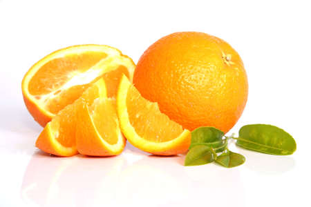 Juicy oranges whole and cut Stock Photo