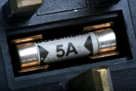 amp: Close up of a 5 amp fuse in its holder in a plug