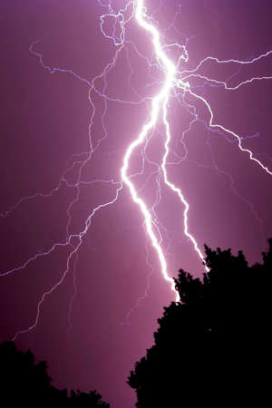 phenomena: Huge bolt of lightning against a dark sky Stock Photo