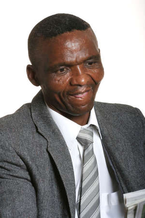 African business man in suit and tie reading a newspaper photo