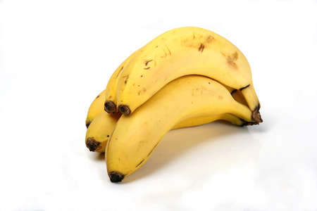 skins: Bunch of ripe bananas with yellow skins