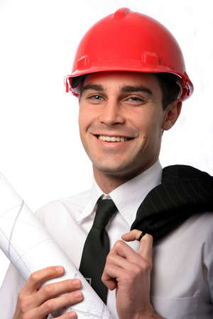 Handsome young architect with red safety hat and plan photo