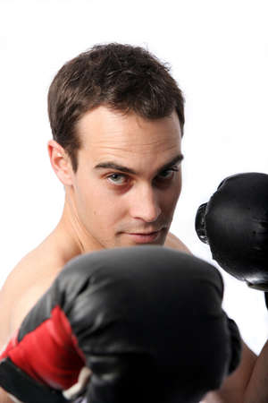 Young male boxer with red and black boxing gloves photo