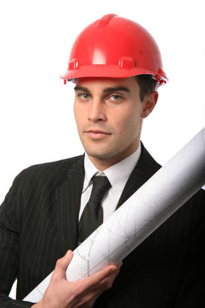 Handsome young architect in suit with red safety hat and plan photo
