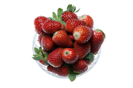 Bowl of juicy red ripe strawberries on white background photo