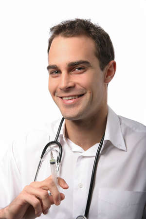 Friendly young medical doctor with a syringe and needle in his hand photo