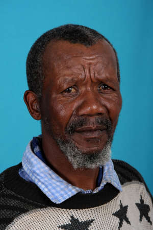 Senior African man with beard and sad expression photo