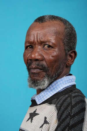 Portrait of a senior African man with a grey beard photo