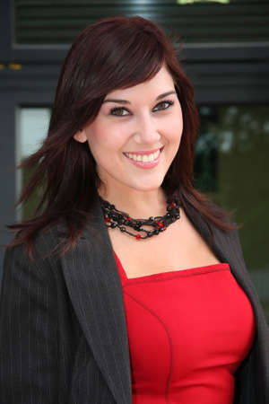 Beautiful young business woman with brown hair in red top and jacket Stock Photo - 3754270