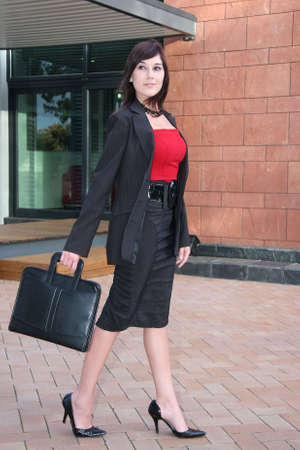 Attractive lady executive in red top and suit with briefcase Stock Photo - 3754269
