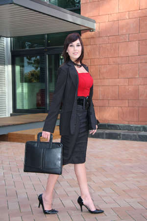 Gorgeous businesswoman walking with a briefcase Stock Photo - 3784829
