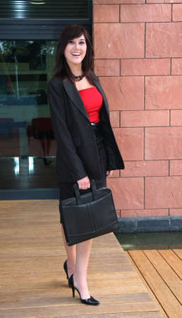 Beautiful and happy business woman in red top and black suit Stock Photo - 3784881