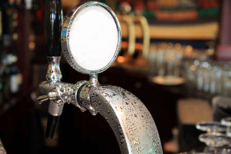 rascunho: Draft beer tap covered in condensation water droplets