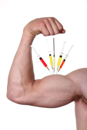 hormone  male: Muscular bicep of young man depicting steroid use - isolated Stock Photo