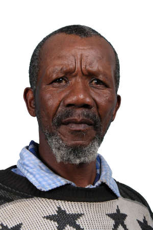 pensioner: Senior African man with beard and sad expression isolated on white