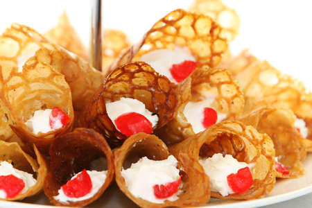 snaps: Brandy snaps wafer cones with cream and cherries
