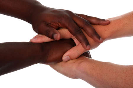 Hands of black and white males clasped together Stock Photo