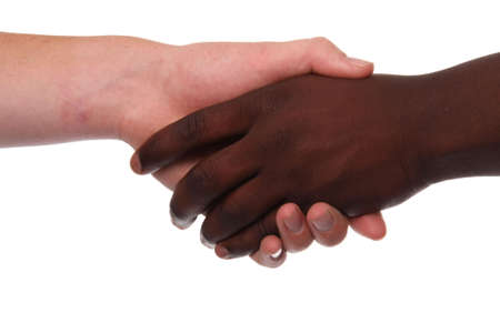 men shaking hands: Black and white hands shaking in friendly agreement
