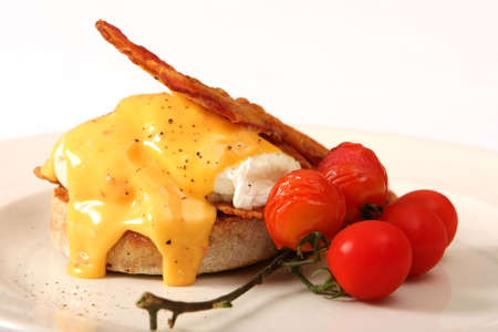 smothered: Delicious breakfast of fried egg smothered in cheese with crispy bacon strips