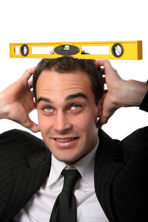 headed: Stressed businessman trying to remain level headed Stock Photo