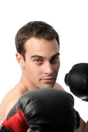 Handsome young man in boxing pose on white background photo