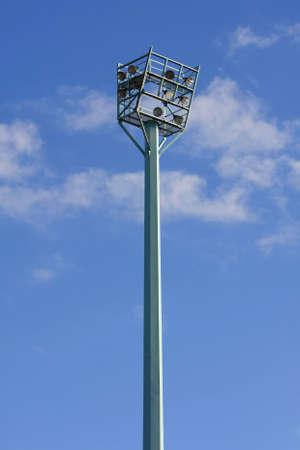 High mast lighting tower against blue sky photo