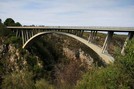 Concrete bridge and arch spanning a river gorge in South Africa photo