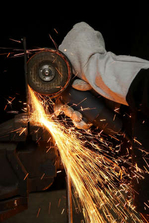 Shower of orange sparks from a worker grinding steel Stock Photo - 4627984