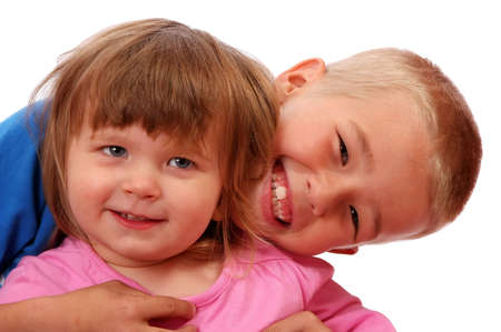 Elder brother with big smile hugging his younger sister Stock Photo - 4861891