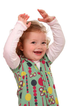 hooray: Cute little girl with her hands up above her head cheering