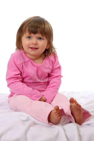 mischievious: Cute two year old girl with a mischievious grin