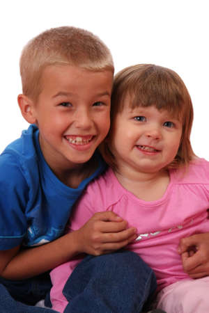Brother and sister with big grins on their faces Stock Photo - 4939357