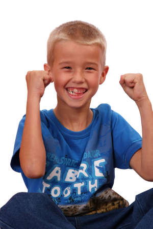 muscle boy: Young blond boy with his hands up and smiling