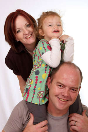 Happy family with cute little girl on her fathers shoulders Stock Photo - 5032195