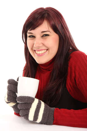 Pretty happy and smiling lady in winter clothes and woolen gloves photo