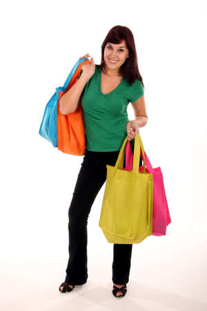 Pretty smiling brunette girl with colorful shopping bags Stock Photo - 5036319