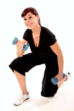Pretty exercise woman with weights in hands photo