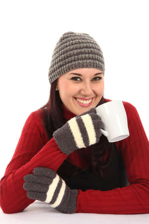 Gorgeous young lady dressed for winter with cap and gloves photo