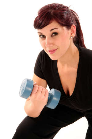 Beautiful brunette woman working out with dumbell weights Stock Photo - 5215211