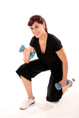 Beautiful brunette woman working out with dumbell weights Stock Photo - 5250370