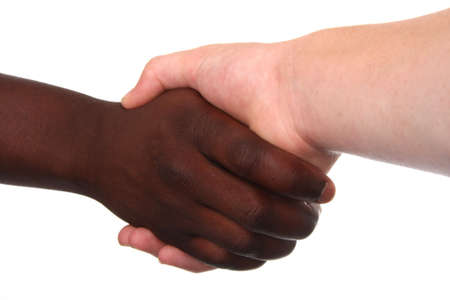 Black and white hands shaking in friendly agreement Stock Photo - 5278738