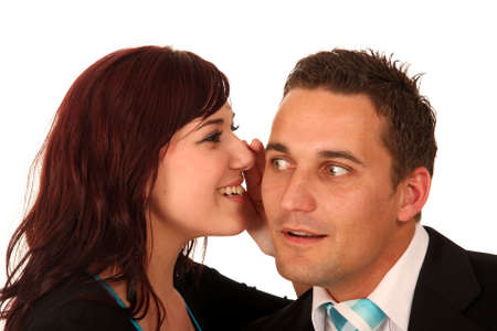 Beautiful brunette woman whispering into her boyfriends ear