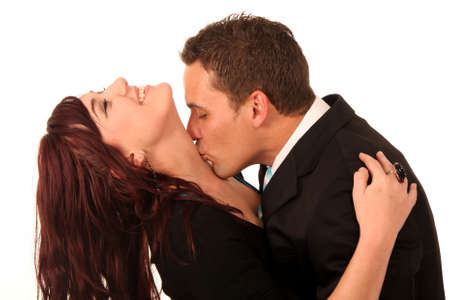 Young hansome man kissing his beautiful girlfriend on her neck Stock Photo - 5427782